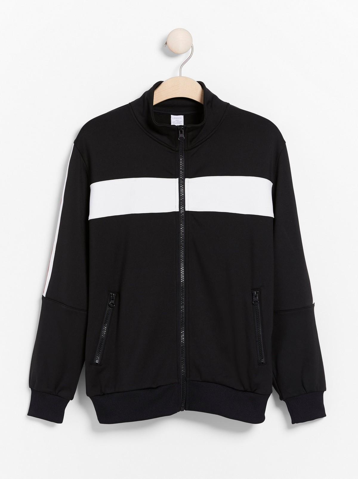 Svart WCT jakke med glidelås og striper på sidene | Lindex