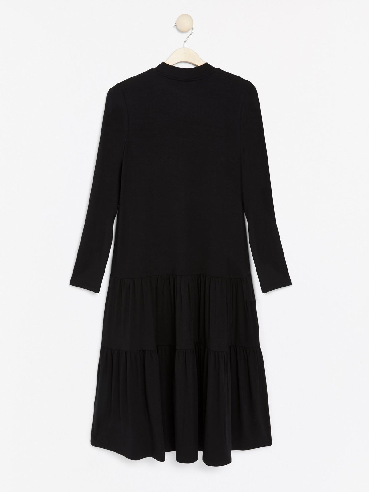 svart klänning a linje
