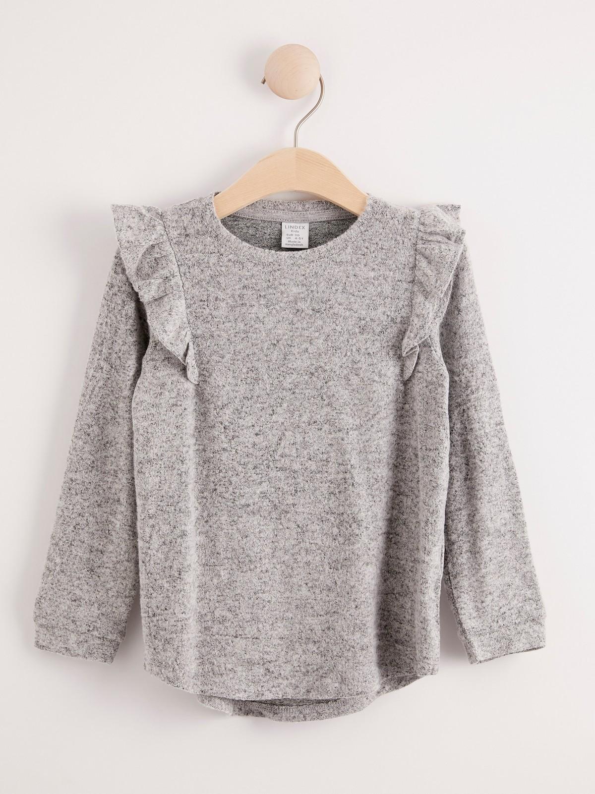 Finstickad långärmad tröja med volang