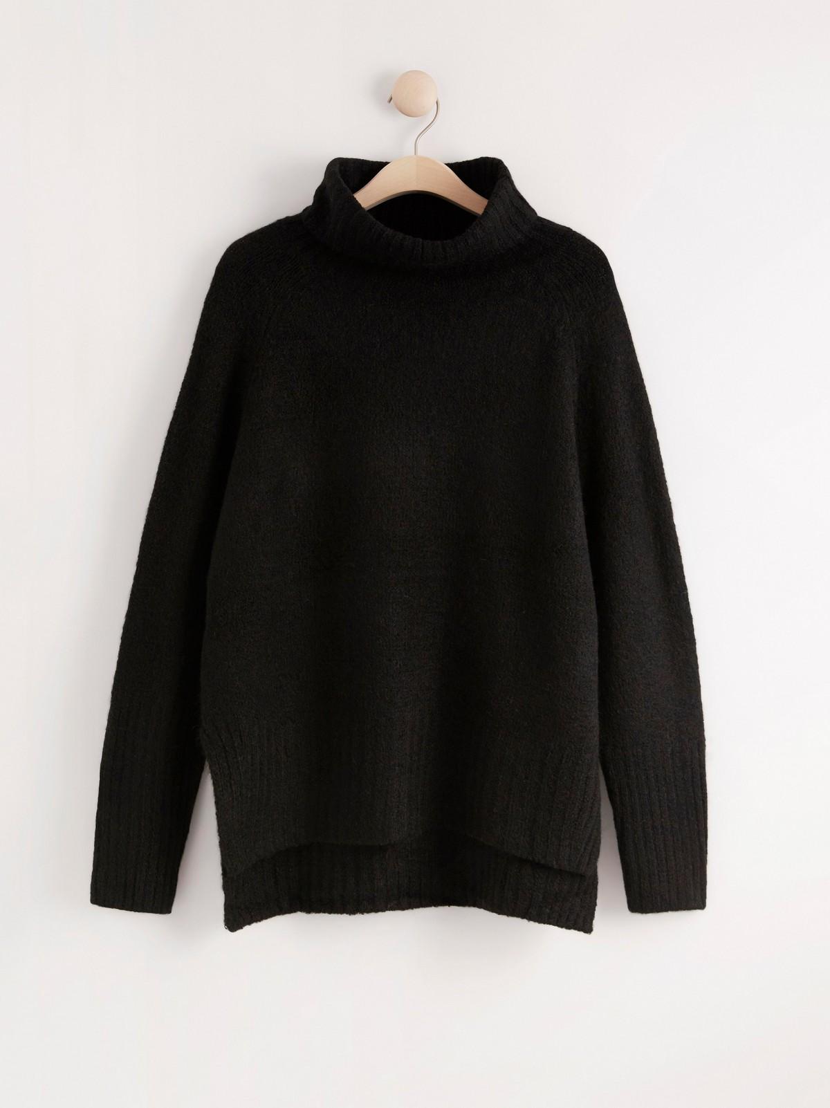 Strikket genser med rullekrage