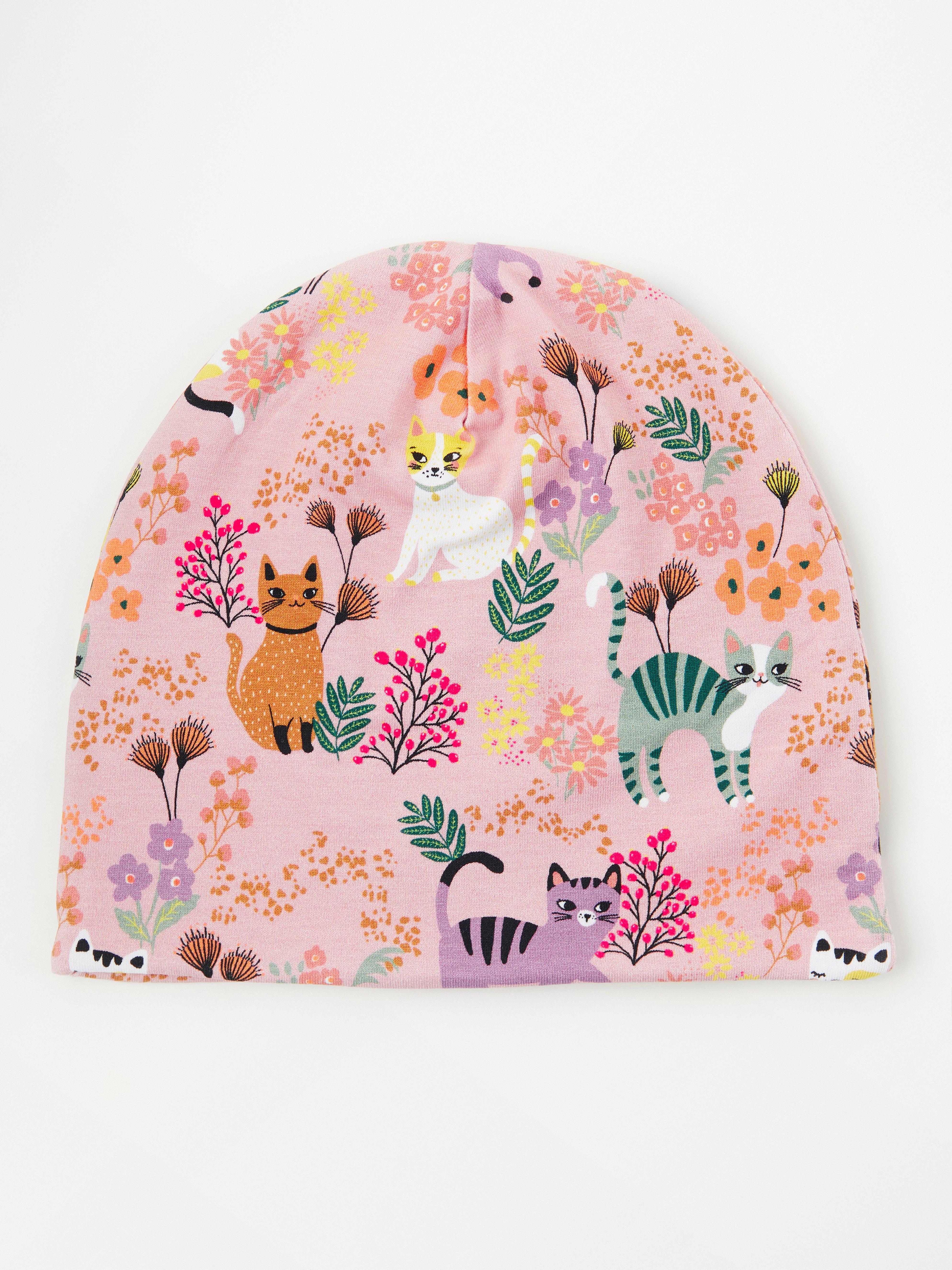 Trikåmössa med katter och blommor