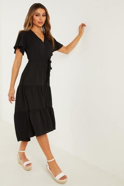 Black Wrap Dip Hem Dress