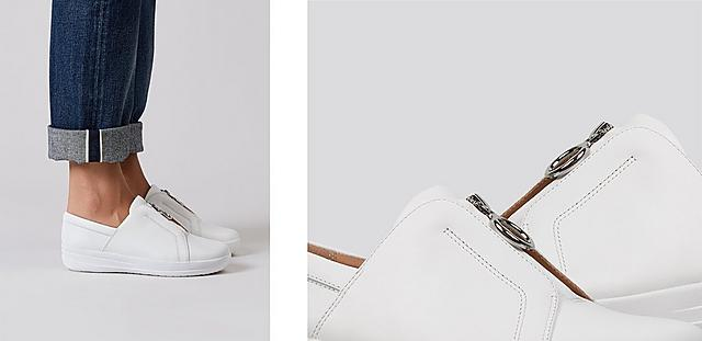 White Tennis style sneakers featuring zip detailing.