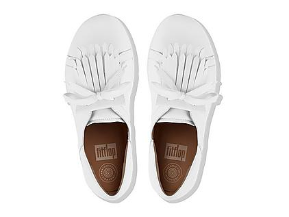 Women's white leather sneakers with fringe detail.