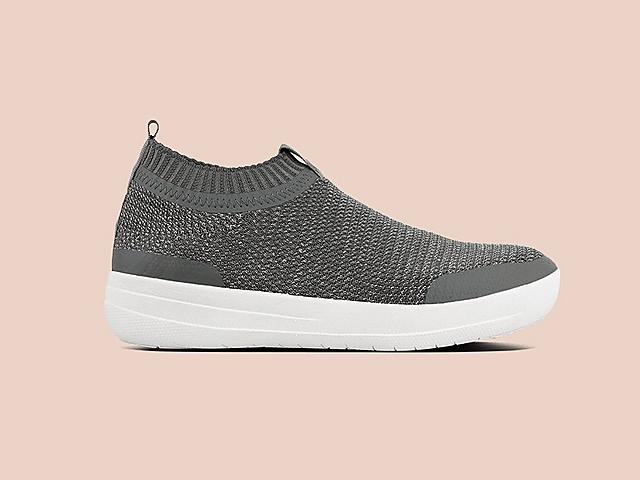 Soft, stretchy slip-on knitted sneakers featuring a metallic weave. Shown in Grey.