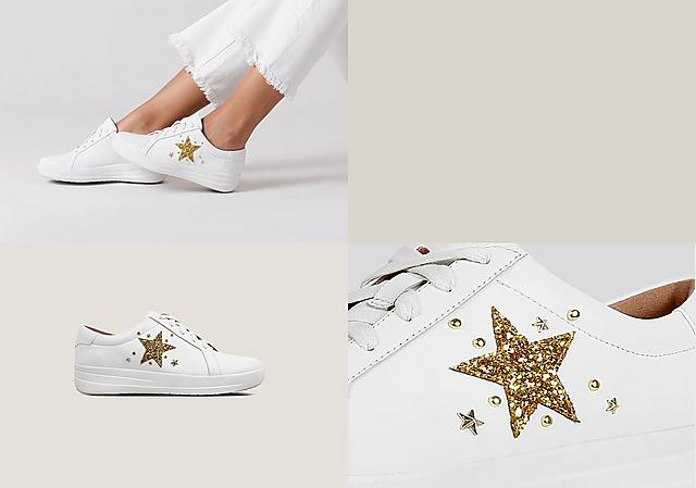 White leather Tennis style sneakers with gold embellished star print on the side and laces.
