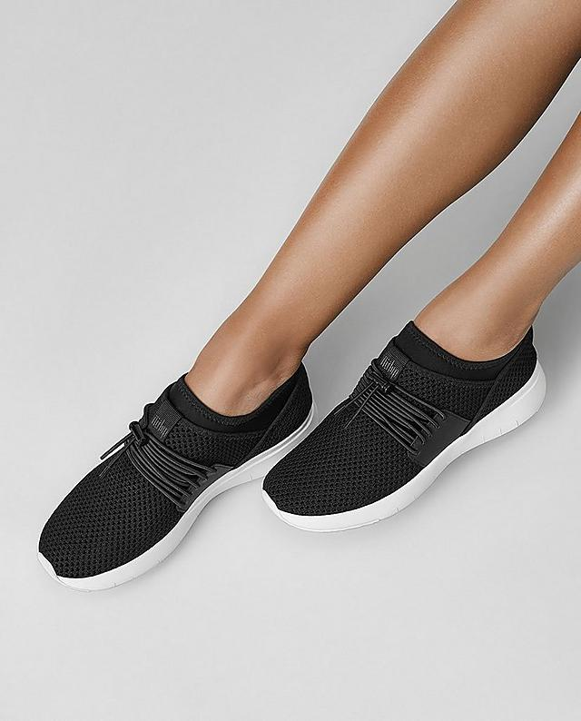 Fitflop Airmesh  slip-on sneakers in black with light stretchy uppers and bungee cord laces.