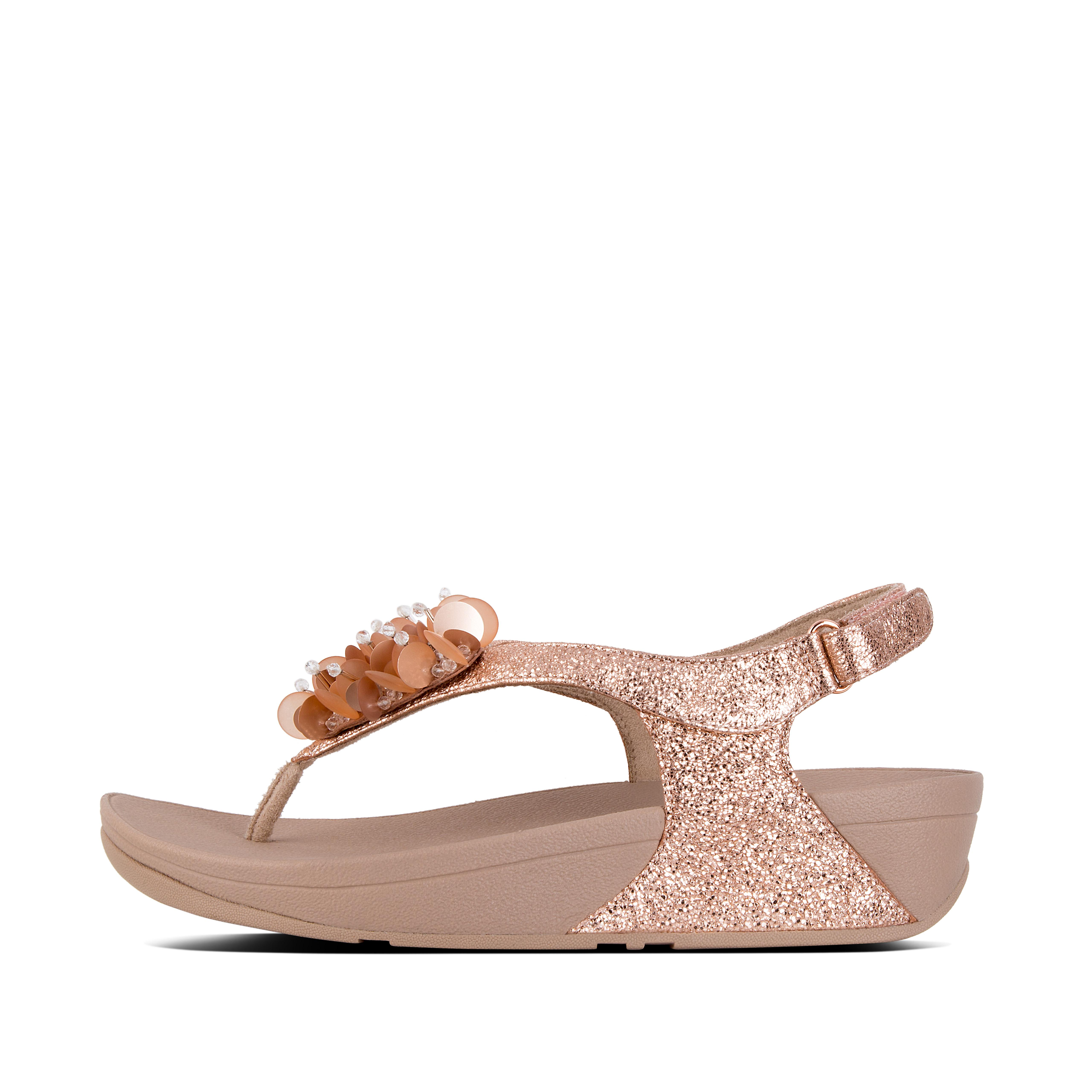 Heaps of tonal beads give these sandals a carnival feel. With comfortable, padded leather uppers and adjustable back-straps - our über-comfortable, pressure-diffusing midsoles means you can dance all night (and day).