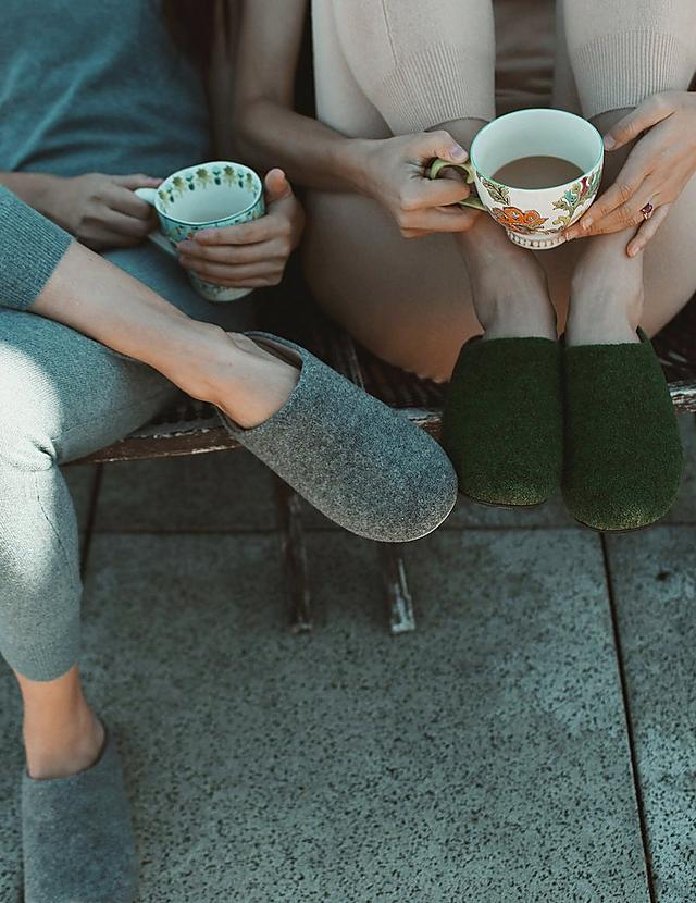 Softly padded, wool felt slippers shown in green and grey.