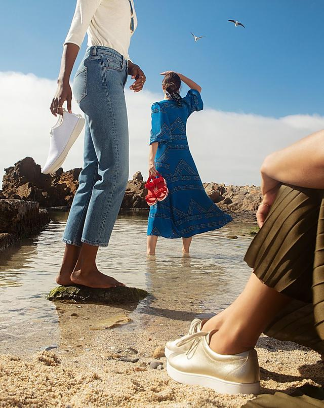 Women on South African Beach wearing Fitflop Footwear, Sandals and Sneakers.