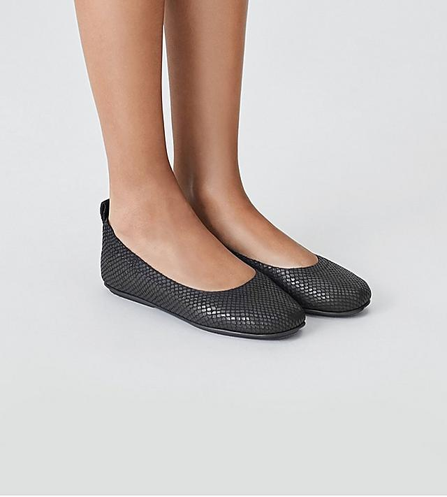 Fitflop Leather Ballerinas with snake-print textured material in black.
