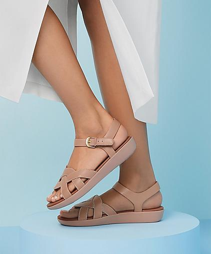 Fitflop Elyna leather sandals in nude, featuring woven straps to the front and an adjustable back-strap.