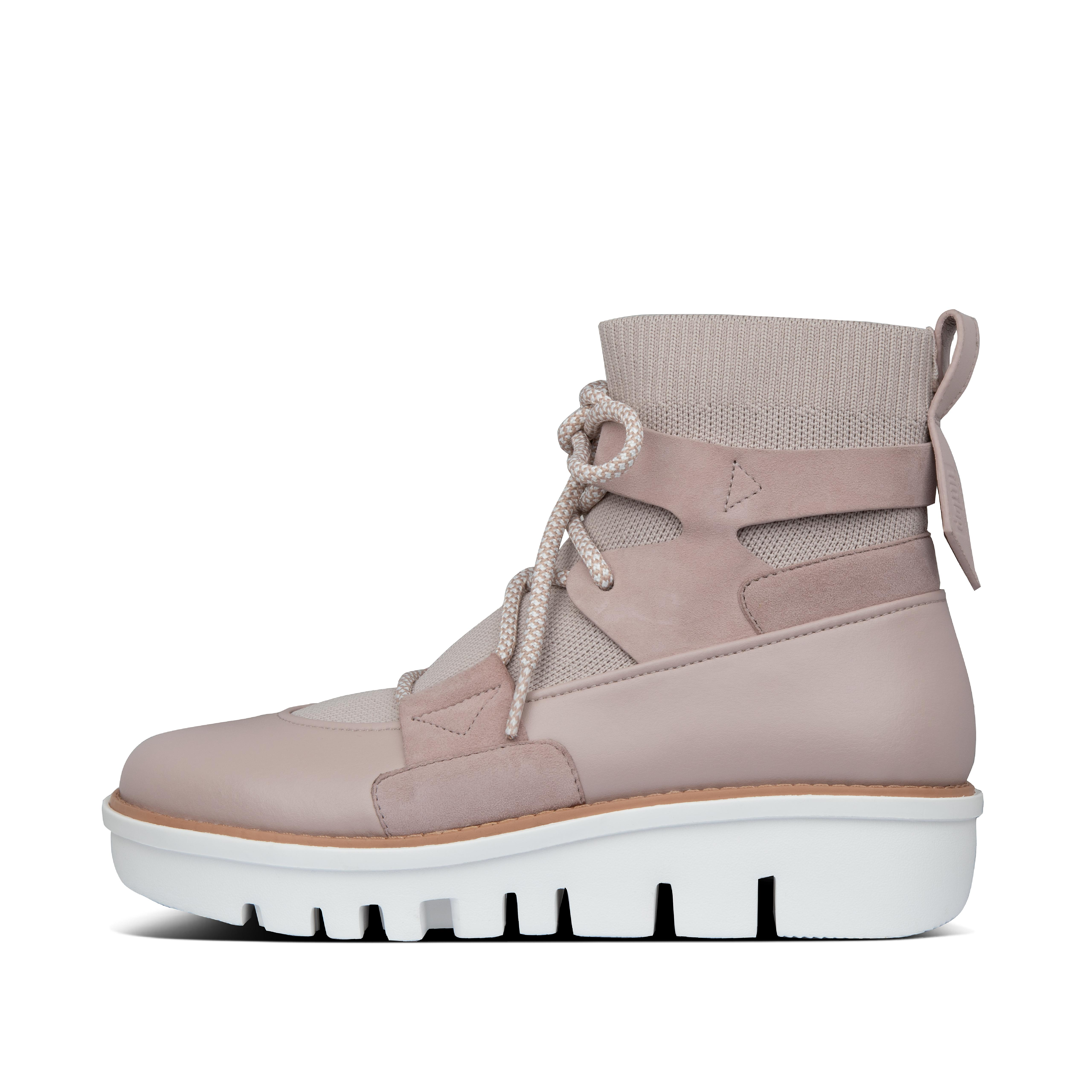 Our high-fashion take on the hiker trend. These Nordic-inspired boots sport directional details like two-tone ski-style laces, mixed-material detailing (smooth faux-leather and suede) and chunky lug soles - but are practical too. This version is in a cozy, stretchy engineered knit. And those statement soles are grip-tested and feature our light, all-day cushioning Ergocom FF™ midsole tech. The peak of chic for a trek to the mall, park, coffee shop.