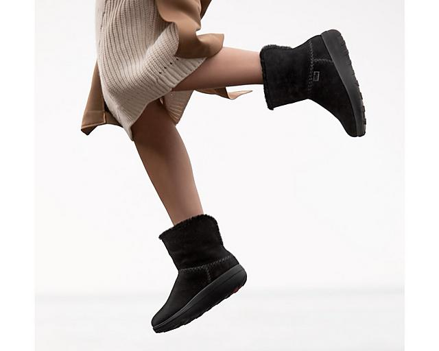 Fitflop Mukluk shearling boots in black.