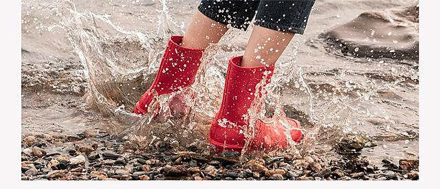 Fitflop WonderWelly, women wearing red wellington boots.