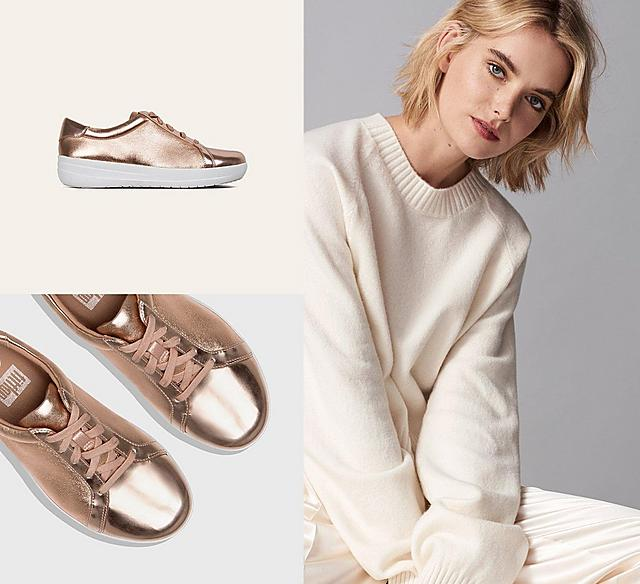 Metallic Rose Gold F-Sporty sneakers with a white base.