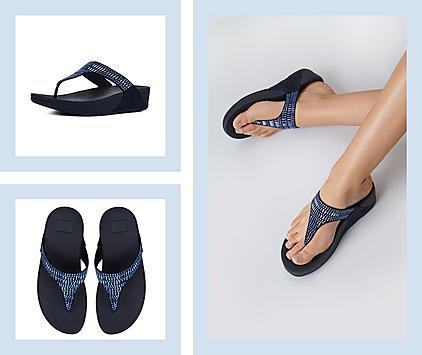 Woman wearing blue toe post sandals.