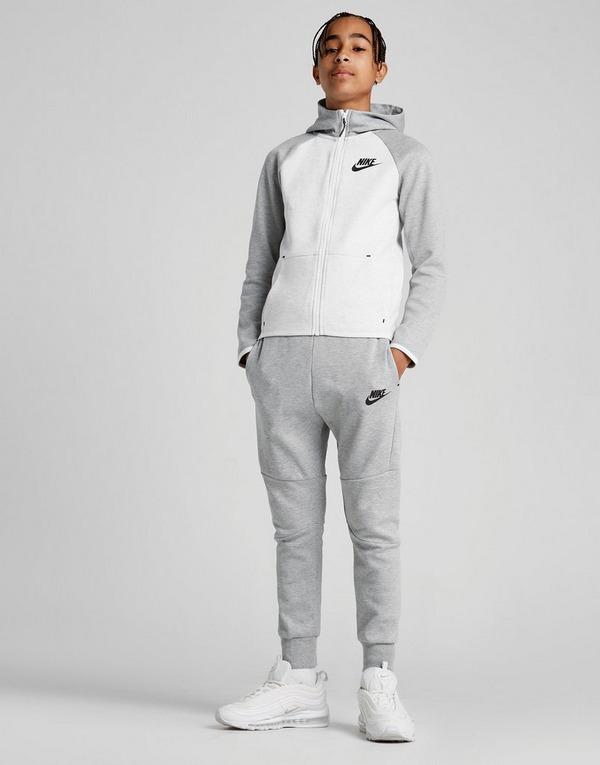 Shoppa Nike Tech Träningsbyxor Junior i en Grå färg   JD