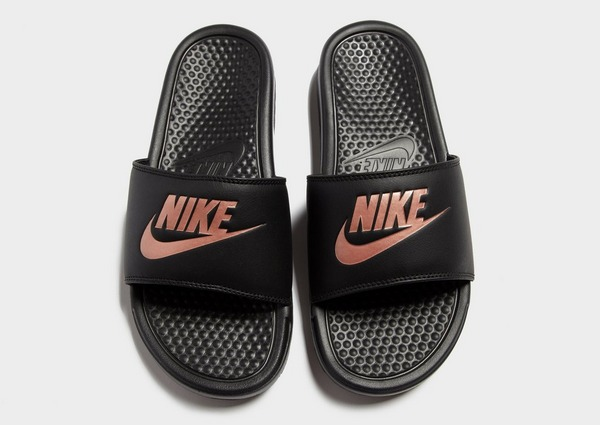 Compra Nike chanclas Benassi Just Do It para mujer en Negro ...