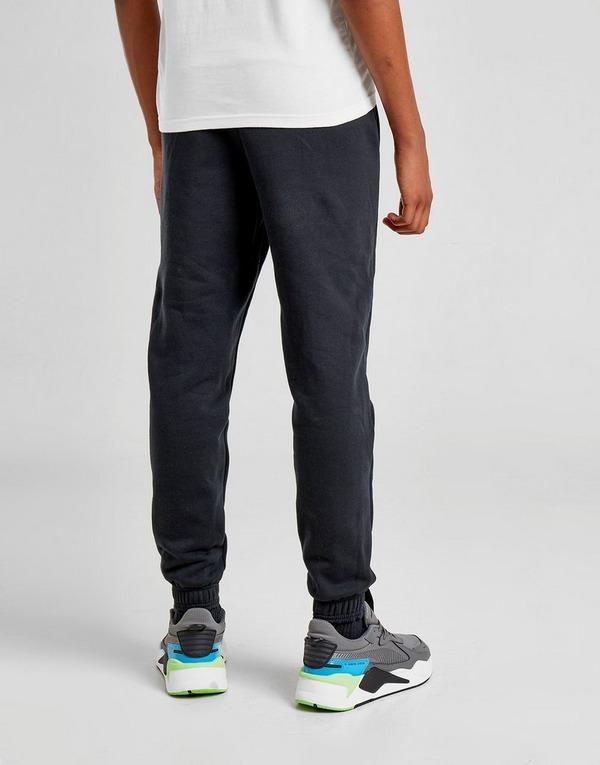 PUMA pantalón de chándal Core Logo júnior