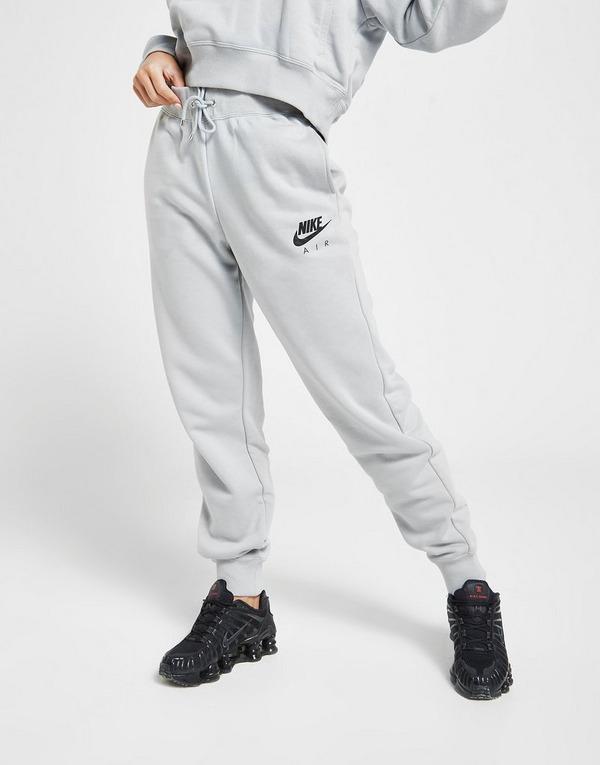 Shoppa Nike Air Fleecebyxor Dam i en Grå färg | JD Sports