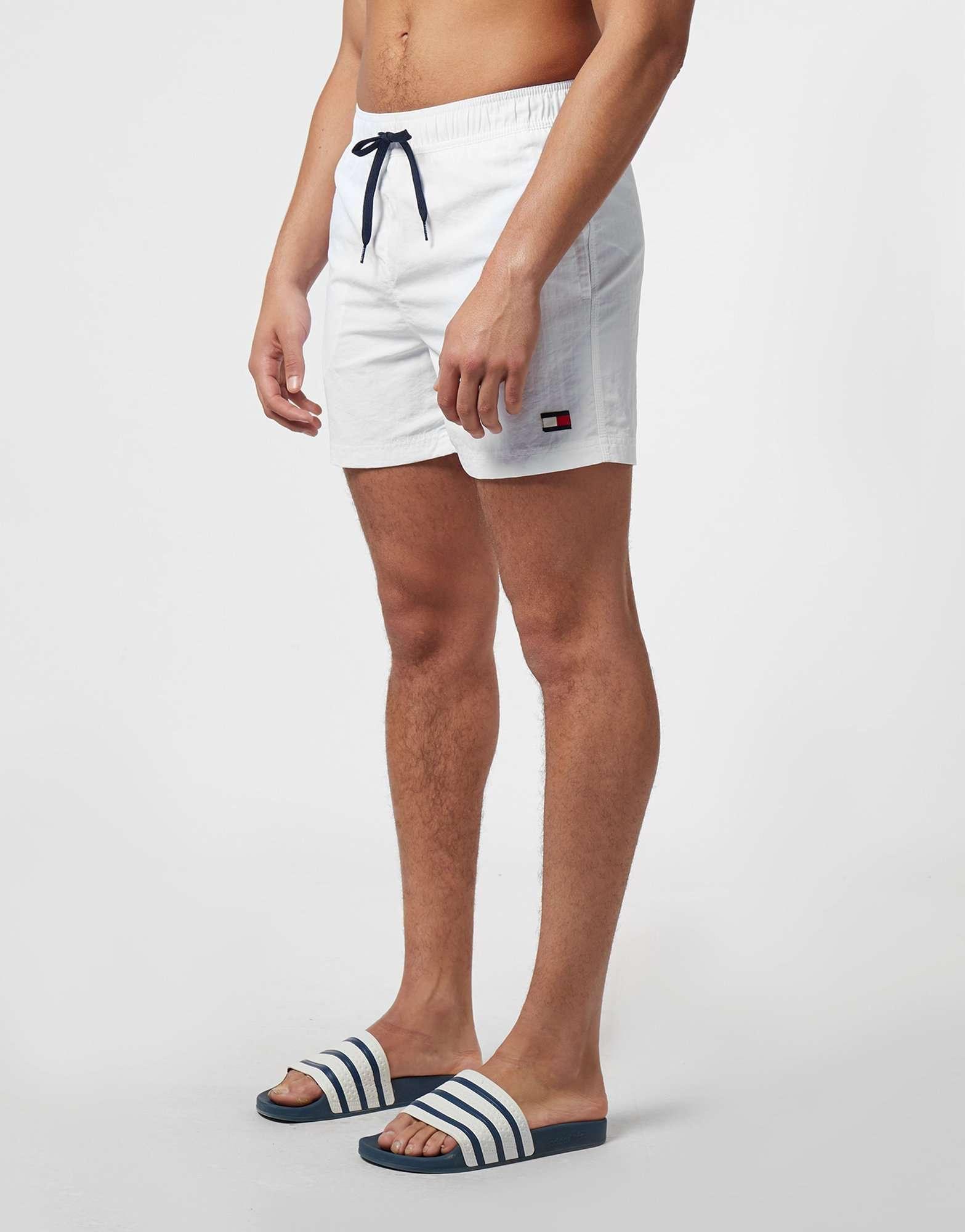 8dec8ebcc49e Tommy Hilfiger Logo Side Stripe Swim Shorts | scotts Menswear
