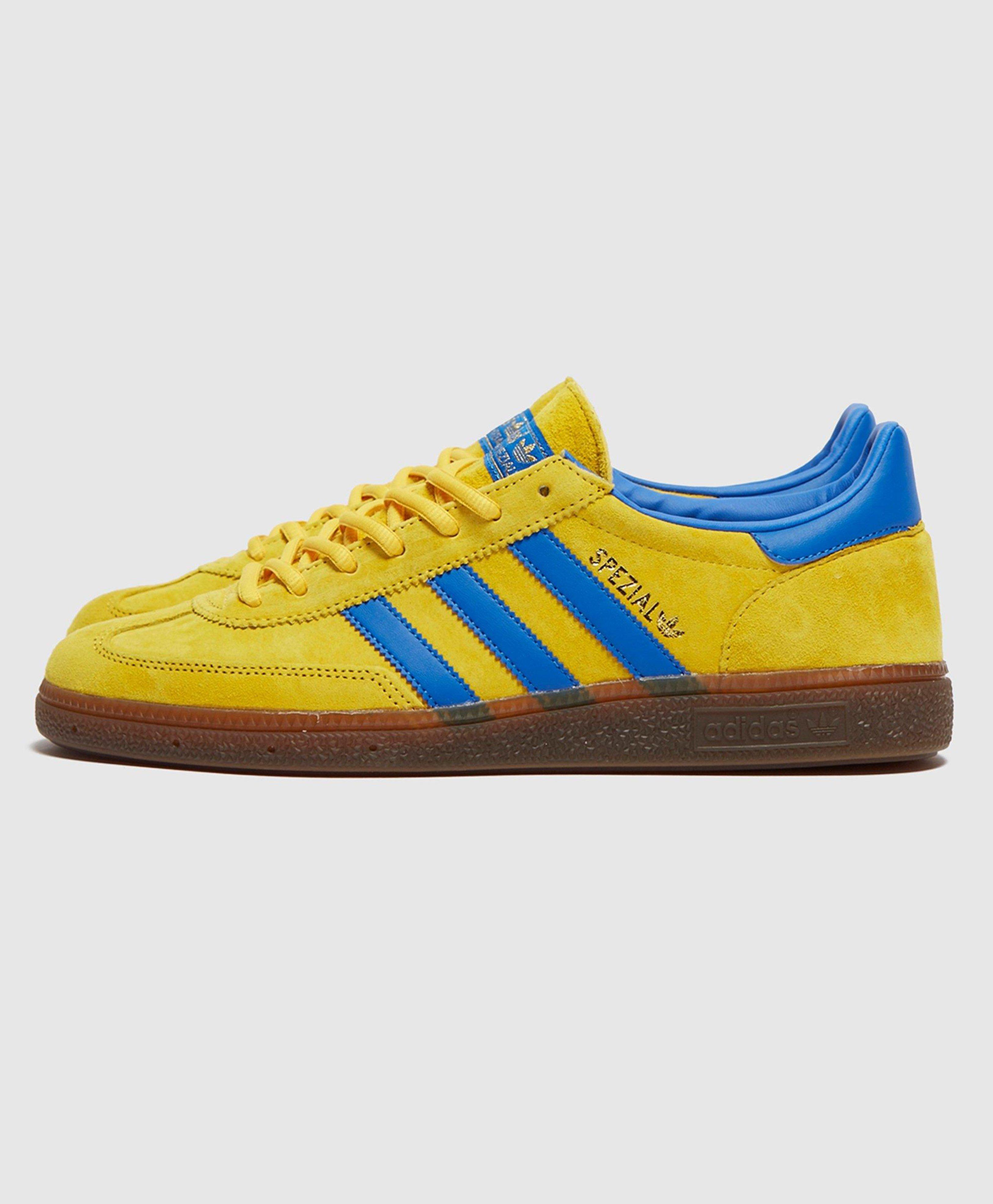 yellow adidas trainers