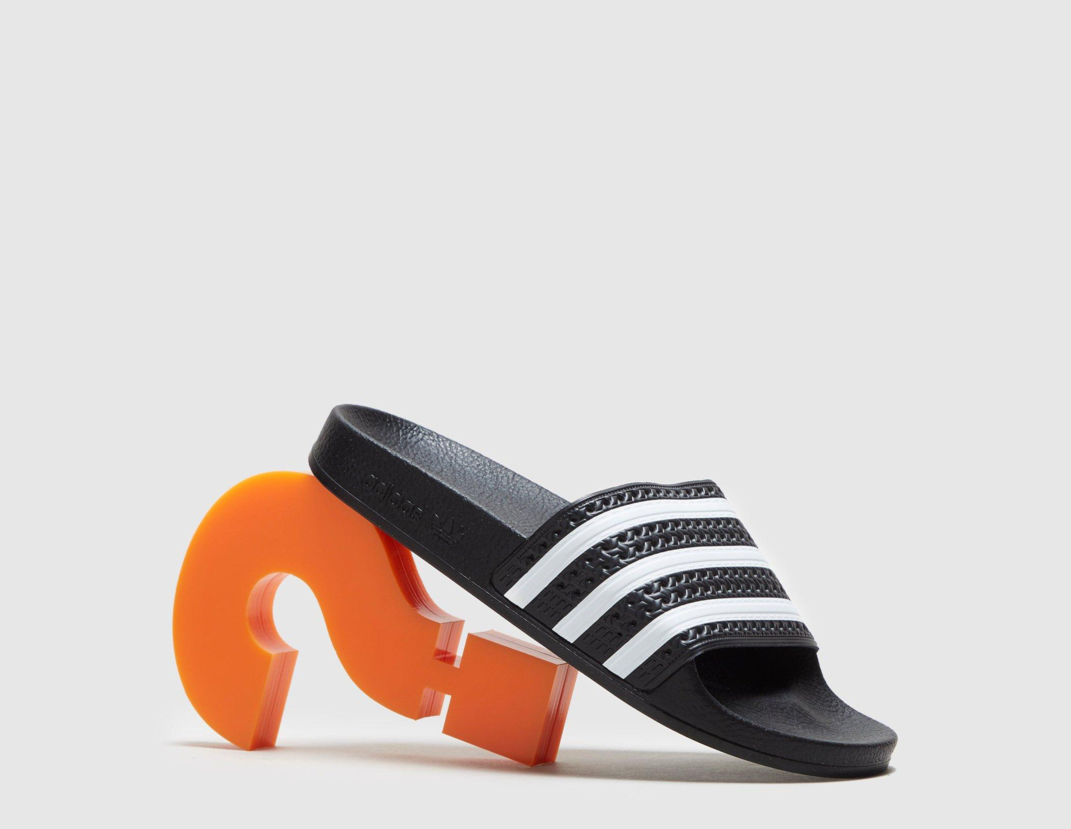 on sale ef58e 6ae21 adidas Originals Adilette Slides Women s