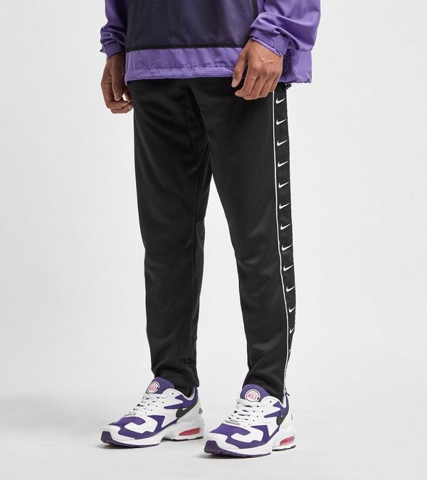 pantalon nike logo tape