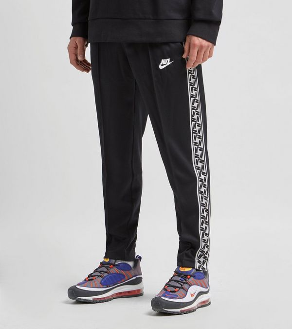 7af10223 Nike Taped Poly Track Pants | Size?