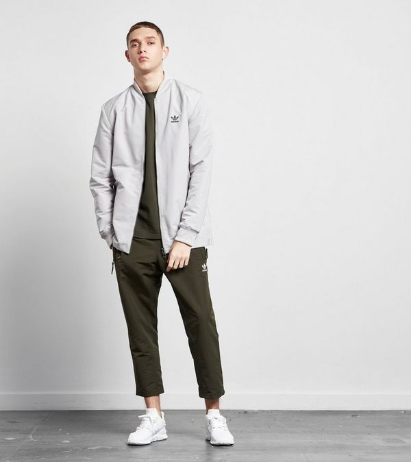 differently 73f46 9bbf2 adidas Originals Fallen Future Woven Track Pant