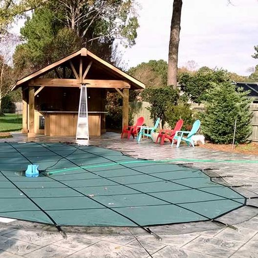 Pro Supreme Solid 16' x 34' Rectangle Safety Cover with Kleen Screen and Sure-Flo Full Length Drain, Green