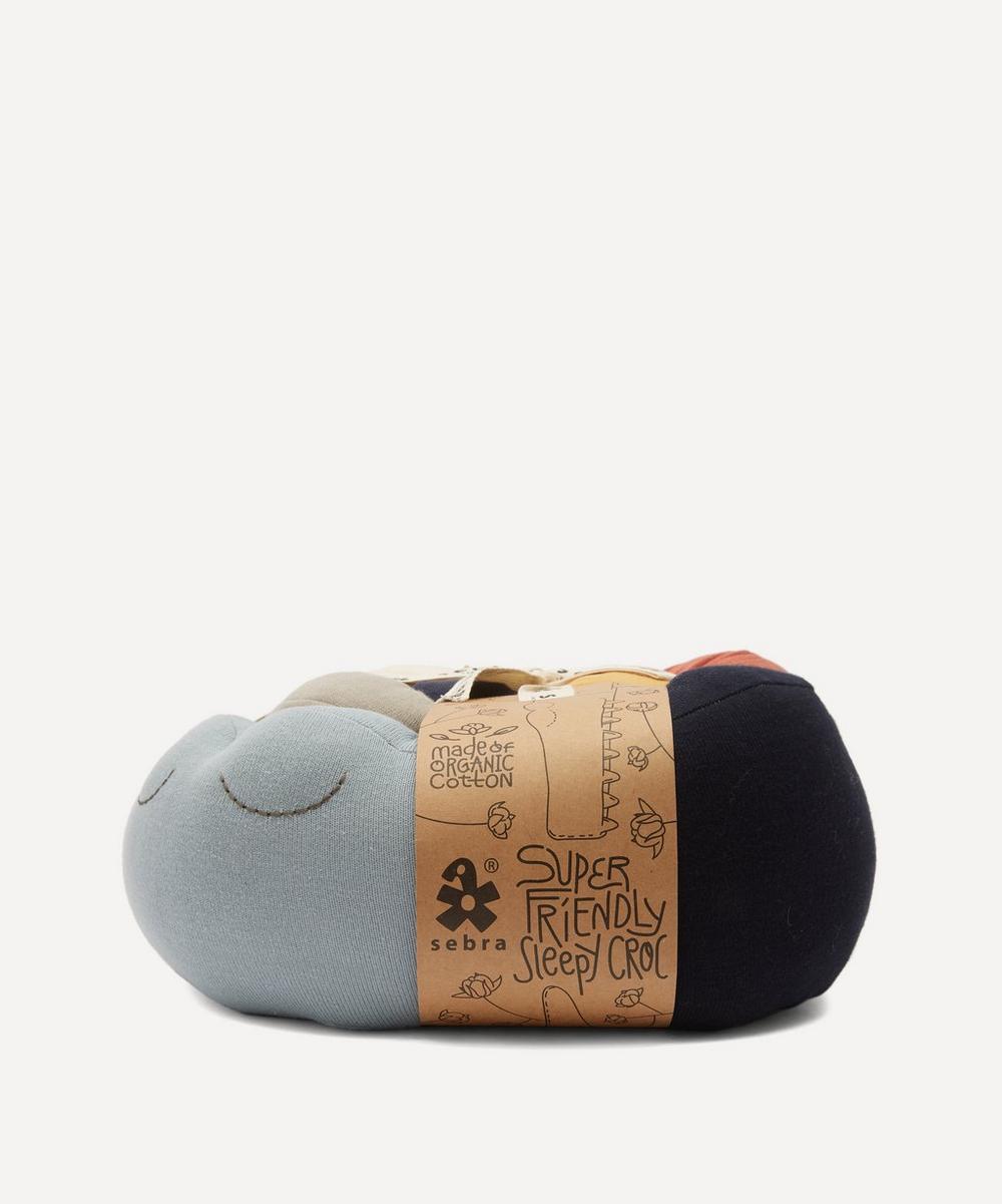 Sebra - Sleepy Croc Knitted Cushion
