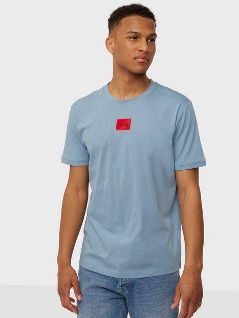 Se HUGO Diragolino212 10229761 01 T-shirts & undertrøjer Medium Blue ved NLY Man
