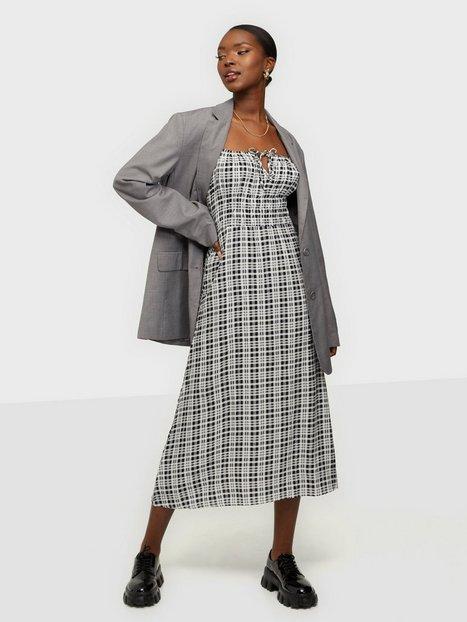 Faithfull the Brand Jasmina Midi Dress Loose fit dresses