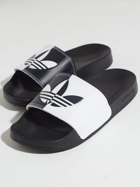 Se Adidas Originals Adilette Lite W Tøfler ved Nelly