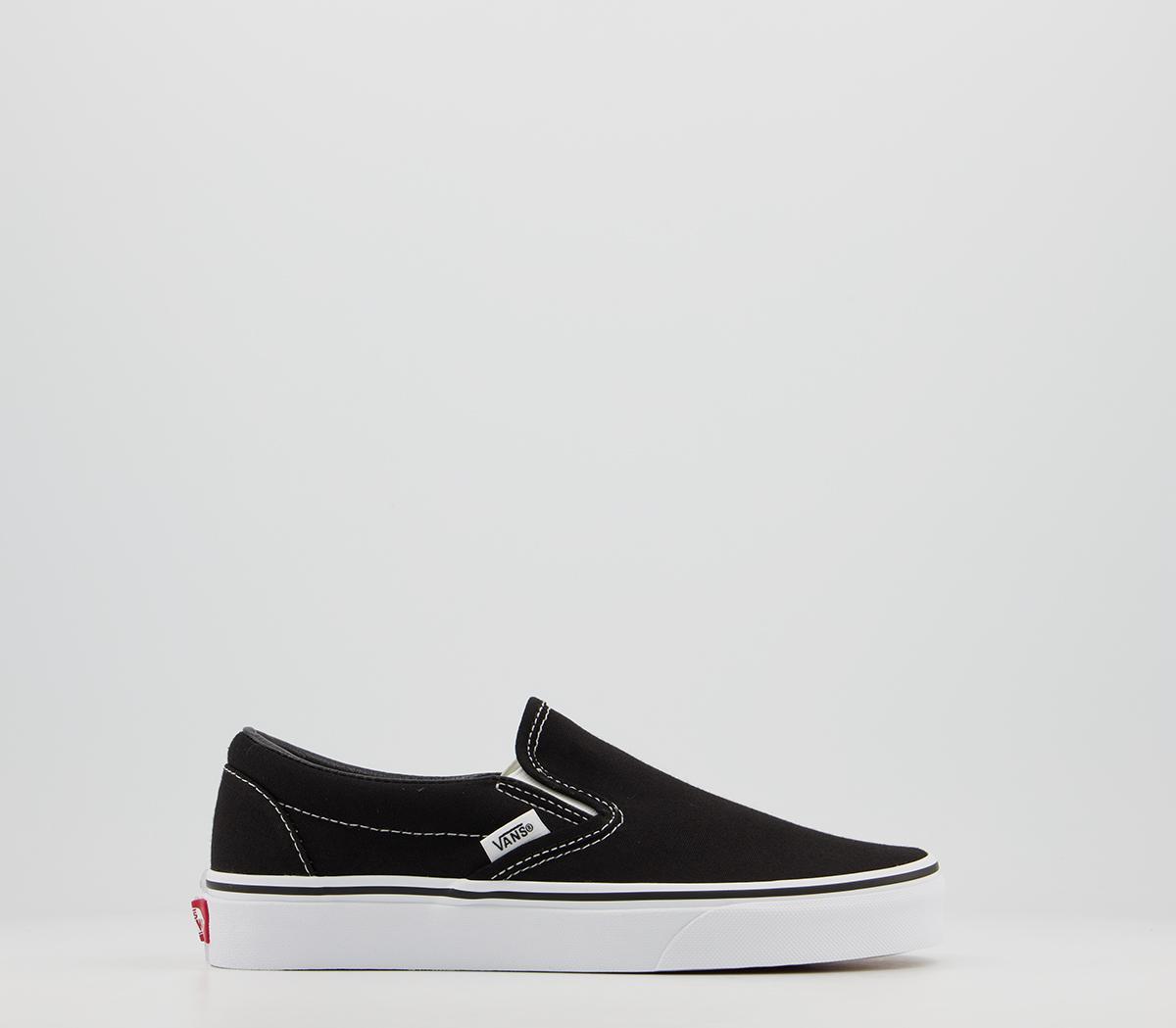 vans white and black slip on
