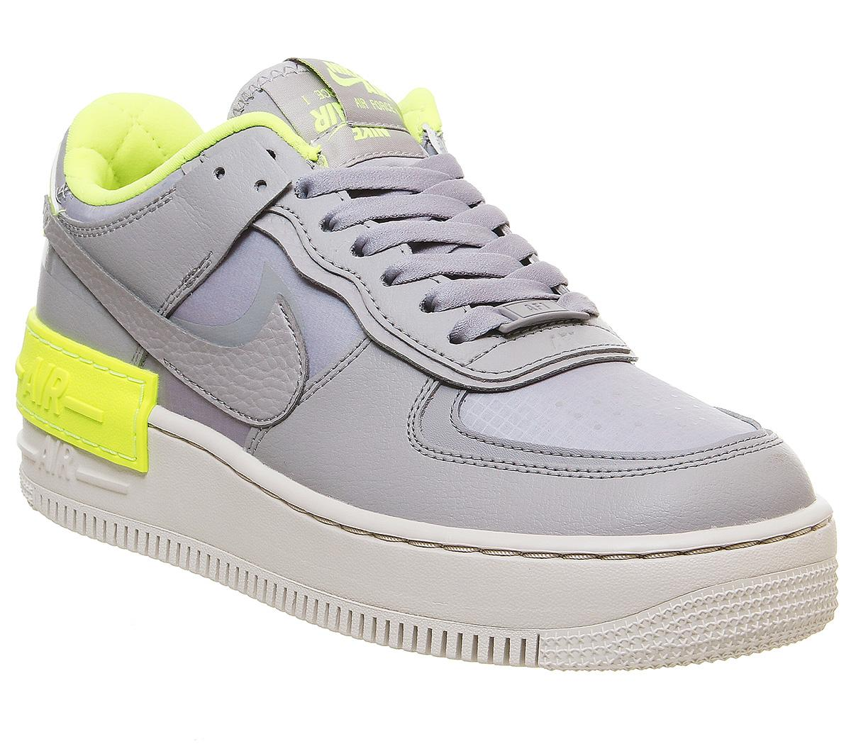 Nike Air Force 1 Shadow Trainers Atmosphere Grey Light Orewood Brown Volt Hers Trainers Dressed in a summit white,flash crimson,dark sulfur and astronomy blue dressed in a atmosphere grey,vast grey and thunder grey color scheme,the nike air force 1 '07 lv8 2 atmosphere grey is a premium version. air force 1 shadow trainers