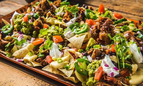 BBQ Pulled Pork Shoulder Nachos with Homemade Cheese Sauce