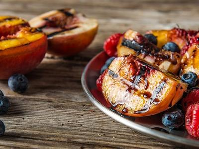 Grilled Stone Fruit with Berries & Cream Recipe