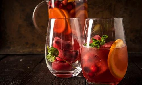 Cran-Apple Tequila Punch With Smoked Oranges