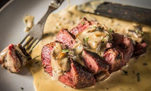 Grilled Peppercorn Steaks with Mushroom Cream Sauce