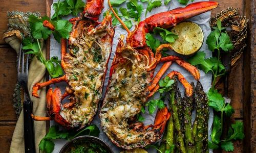 Caribbean Curry Grilled Lobsters with Garlic Lime Asparagus