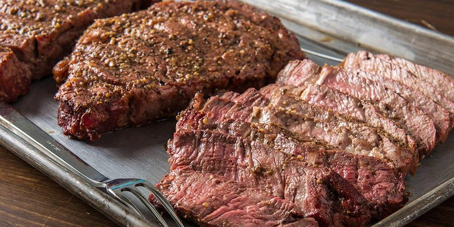 image of Grilled Rib-Eye Steaks by Doug Scheiding