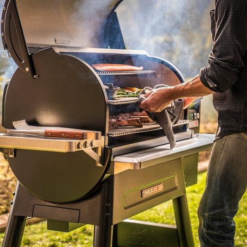 Timberline_1300_Wood_Pellet_Grills_Hero_Person_Cooking_01
