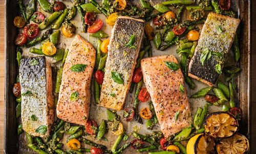 Roasted Sheet Pan Salmon with Spring Vegetables and Pesto