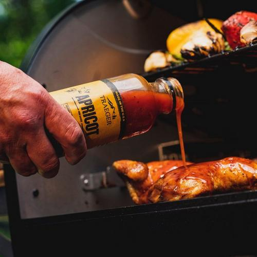 traeger-apricot-bbq-sauce-lifestyle-pouring