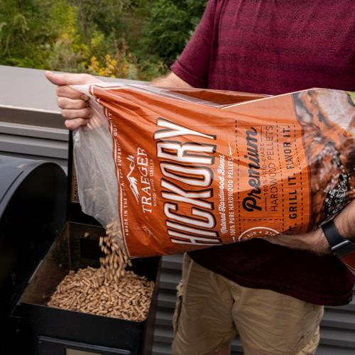 traeger-hickory-pellets-lifestyle-pouring