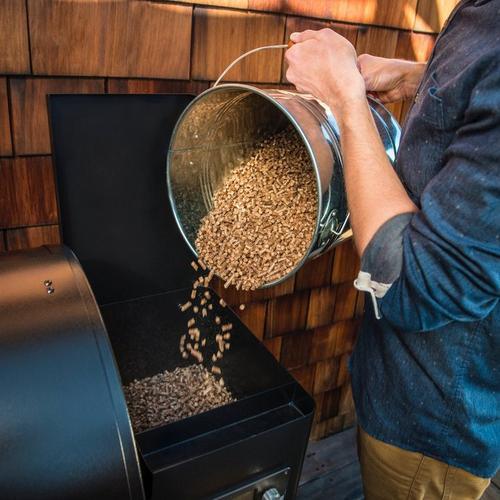 traeger-pellet-storage-metal-bucket-lifestyle-pouring