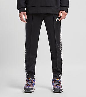 f5aad7ba5f4 Nike Taped Poly Track Pants ...
